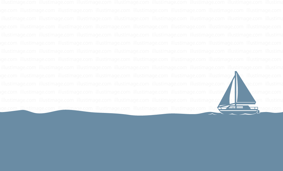 A silhouette of a yacht floating in the sea