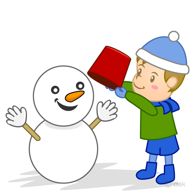 A boy making a snowman