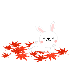 Rabbits relaxing in autumn leaves
